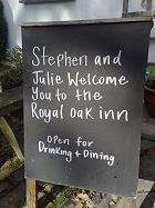 Welcome board - Stephen and Julie welcome you to the Royal Oak Inn